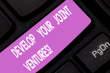 Text sign showing Develop Your Joint Ventures. Conceptual photo Business partnership cooperation growing Keyboard key Intention to create computer message pressing keypad idea