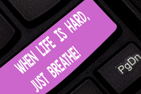 Text sign showing When Life Is Hard Just Breathe. Conceptual photo Take a break to overcome difficulties Keyboard key Intention to create computer message pressing keypad idea