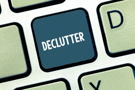 Writing note showing Declutter. Business photo showcasing remove unnecessary items from untidy or overcrowded place Keyboard Intention to create computer message keypad idea