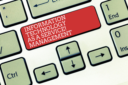 Text sign showing Information Technology Management As A Service. Conceptual photo IT supporting assistance Keyboard key Intention to create computer message, pressing keypad idea Imagens