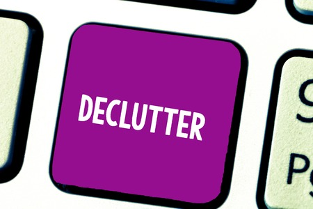 Text sign showing Declutter. Conceptual photo remove unnecessary items from untidy or overcrowded place Keyboard key Intention to create computer message, pressing keypad idea