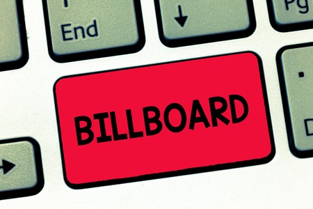 Text sign showing Billboard. Conceptual photo large outdoor board for displaying advertisements hoarding Keyboard key Intention to create computer message, pressing keypad idea