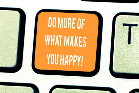 Handwriting text writing Do More Of What Makes You Happy. Concept meaning Keep doing things activities you like enjoy Keyboard key Intention to create computer message pressing keypad idea 免版税图像