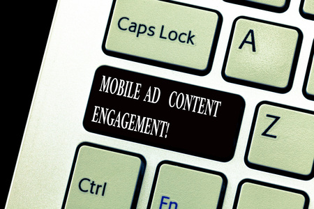 Word writing text Mobile Ad Content Engagement. Business concept for Social media advertising promotion strategies Keyboard key Intention to create computer message, pressing keypad idea