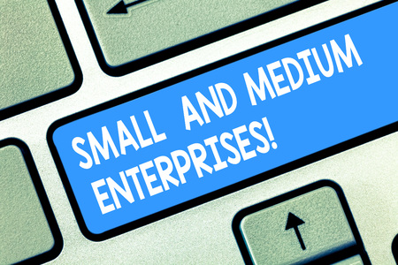 Handwriting text Small And Medium Enterprises. Concept meaning SME growth of startups new business analysisagement Keyboard key Intention to create computer message pressing keypad idea Stock Photo