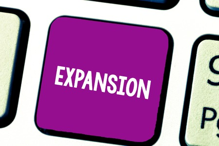 Text sign showing Expansion. Conceptual photo action becoming larger or more extensive enlargement of something Keyboard key Intention to create computer message, pressing keypad idea Imagens