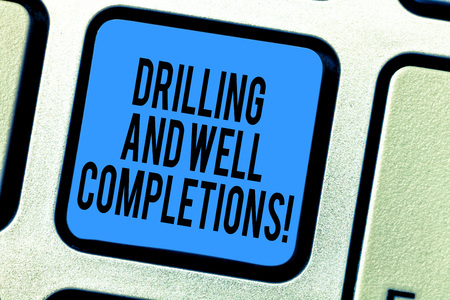Handwriting text Drilling And Well Completions. Concept meaning Oil and gas petroleum industry engineering Keyboard key Intention to create computer message pressing keypad idea