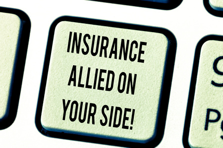 Text sign showing Insurance Allied On Your Side. Conceptual photo Safety support in case of emergency available Keyboard key Intention to create computer message pressing keypad idea