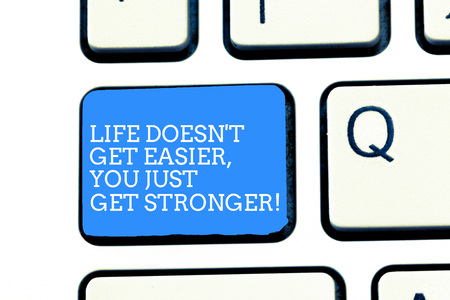 Text sign showing Life Doesn T Get Easier You Just Get Stronger. Conceptual photo Inspiration to keep going Keyboard key Intention to create computer message, pressing keypad idea