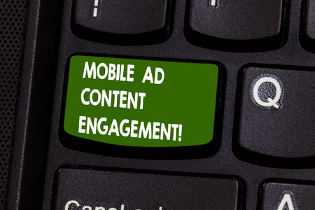 Handwriting text writing Mobile Ad Content Engagement. Concept meaning Social media advertising promotion strategies Keyboard key Intention to create computer message pressing keypad idea