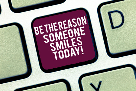Conceptual hand writing showing Be The Reason Someone Smiles Today. Business photo text Make somebody happy Give some joy Keyboard Intention to create computer message keypad idea