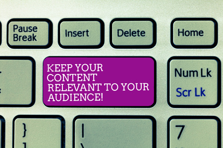 Conceptual hand writing showing Keep Your Content Relevant To Your Audience. Business photo text Good marketing strategies Keyboard Intention to create computer message keypad idea
