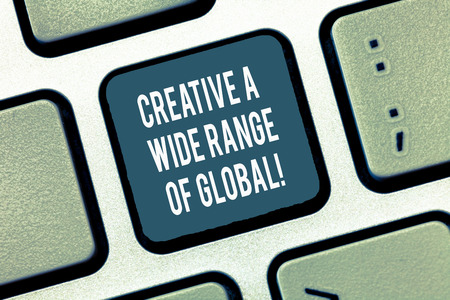 Text sign showing Creative A Wide Range Of Global. Conceptual photo Spread creativity around the world Keyboard key Intention to create computer message, pressing keypad idea Фото со стока