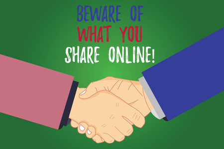 Text sign showing Beware Of What You Share Online. Conceptual photo Be careful with the information you post analysis Shaking Hands on Agreement Greeting Gesture Sign of Respect photo 스톡 콘텐츠