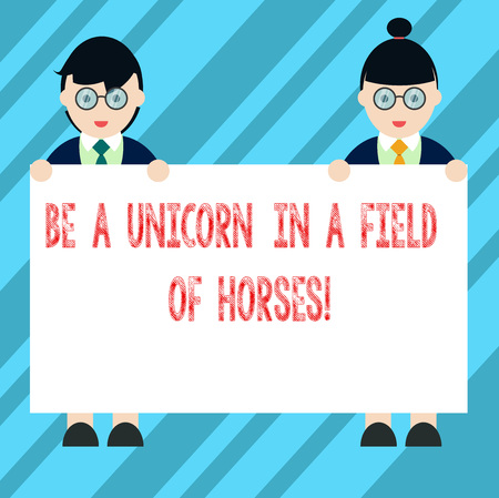 Text sign showing Be A Unicorn In A Field Of Horses. Conceptual photo Make the difference being special Male and Female in Uniform Standing Holding Blank Placard Banner Text Space Stock Photo