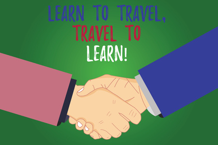 Text sign showing Learn To Travel Travel To Learn. Conceptual photo Make trips for learning new things culture Hu analysis Shaking Hands on Agreement Greeting Gesture Sign of Respect photo Archivio Fotografico