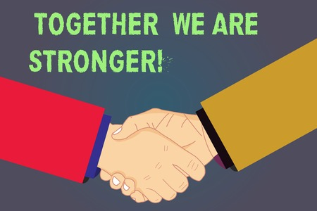 Handwriting text Together We Are Stronger. Concept meaning Working on a team gives best business results Hu analysis Shaking Hands on Agreement Greeting Gesture Sign of Respect photo