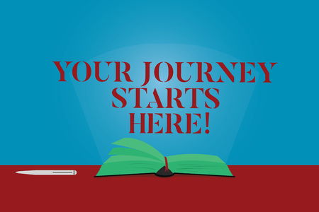 Conceptual hand writing showing Your Journey Starts Here. Business photo text Motivation for starting a business Inspiration Color Pages of Book on Table with Pen and Light Beam Glaring