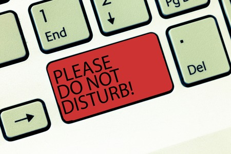 Writing note showing Please Do Not Disturb. Business photo showcasing Let us be quiet and rest Hotel room sign Privacy Keyboard Intention to create computer message keypad idea