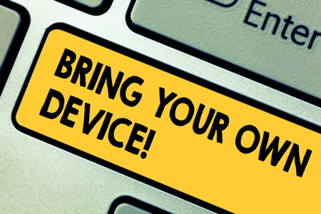 Word writing text Bring Your Own Device. Business concept for Come with demonstratingal computer laptop smartphone Keyboard key Intention to create computer message pressing keypad idea Stock Photo