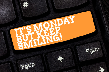 Writing note showing It S Monday But Keep Smiling. Business photo showcasing Have a good start of the week day Motivation Keyboard key Intention to create computer message pressing keypad idea