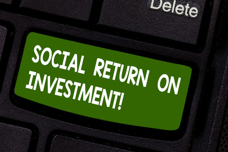 Text sign showing Social Return On Investment. Conceptual photo Invest part of the earnings in donations Keyboard key Intention to create computer message pressing keypad idea