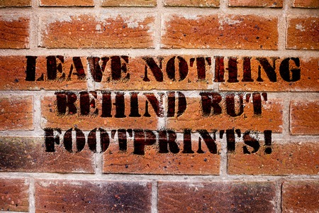 Conceptual hand writing showing Leave Nothing Behind But Footprints. Business photo text Do not look back always go forward Stockfoto
