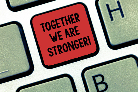 Writing note showing Together We Are Stronger. Business photo showcasing Working on a team gives best business results Keyboard Intention to create computer message keypad idea Stock Photo