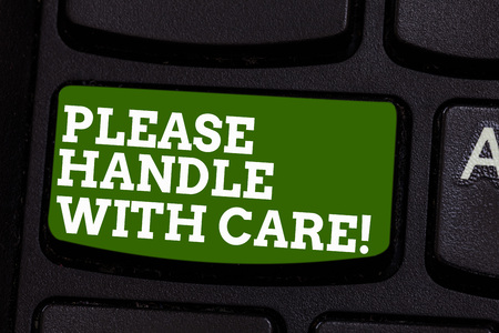 Writing note showing Please Handle With Care. Business photo showcasing Fragile be careful during transportation shipping Keyboard key Intention to create computer message pressing keypad idea Stock Photo