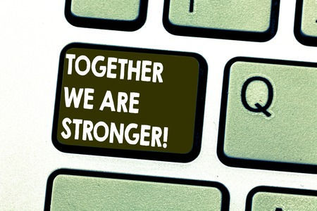 Text sign showing Together We Are Stronger. Conceptual photo Working on a team gives best business results Keyboard key Intention to create computer message pressing keypad idea