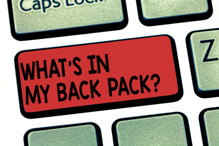 Writing note showing What S Is In My Back Pack. Business photo showcasing Things that are inside your school or travel bag Keyboard key Intention to create computer message pressing keypad idea