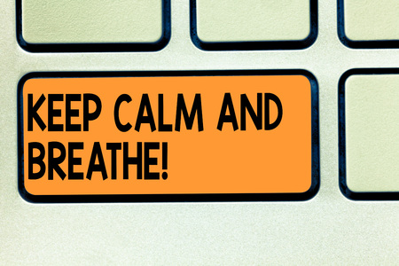 Conceptual hand writing showing Keep Calm And Breathe. Business photo showcasing Take a break to overcome everyday difficulties Keyboard key Intention to create computer message idea 免版税图像