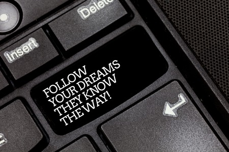 Handwriting text writing Follow Your Dreams They Know The Way. Concept meaning Inspiration motivation to get success Keyboard key Intention to create computer message pressing keypad idea