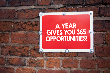 Handwriting text writing A Year Gives Your 365 Opportunities. Concept meaning Fresh new start Motivation inspiration Archivio Fotografico