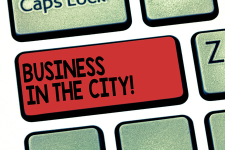 Writing note showing Business In The City. Business photo showcasing Urban companies Professional offices in cities Keyboard key Intention to create computer message pressing keypad idea