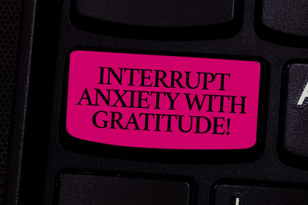 Handwriting text writing Interrupt Anxiety With Gratitude. Concept meaning Be thankful and less stressed out Keyboard key Intention to create computer message pressing keypad idea Foto de archivo