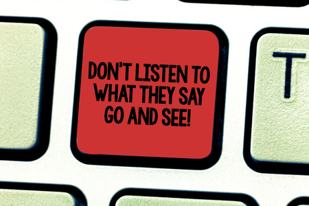 Text sign showing Don T Listen To What They Say Go And See. Conceptual photo Confirm Check by yourself Keyboard key Intention to create computer message pressing keypad idea
