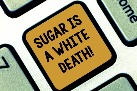 Text sign showing Sugar Is A White Death. Conceptual photo Sweets are dangerous diabetes alert unhealthy foods Keyboard key Intention to create computer message pressing keypad idea Фото со стока