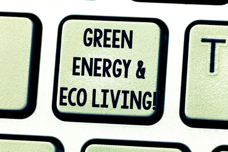 Text sign showing Green Energy And Eco Living. Conceptual photo Environment protection recycling reusing Keyboard key Intention to create computer message pressing keypad idea