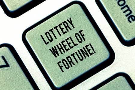 Writing note showing Lottery Wheel Of Fortune. Business photo showcasing Chances good luck gambling addiction gambler Keyboard key Intention to create computer message pressing keypad idea