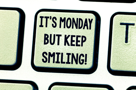 Text sign showing It S Monday But Keep Smiling. Conceptual photo Have a good start of the week day Motivation Keyboard key Intention to create computer message pressing keypad idea Banco de Imagens
