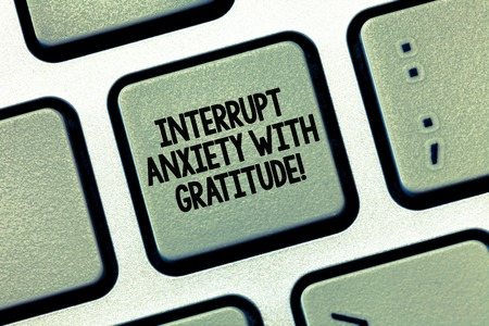 Writing note showing Interrupt Anxiety With Gratitude. Business photo showcasing Be thankful and less stressed out Keyboard Intention to create computer message keypad idea