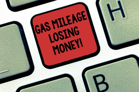 Writing note showing Gas Mileage Losing Money. Business photo showcasing Long road high gas fuel costs financial losses Keyboard Intention to create computer message keypad idea