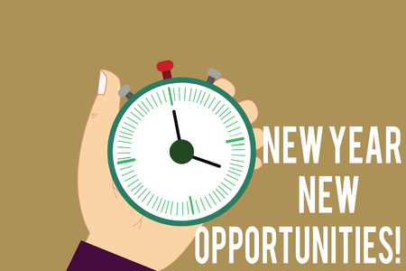 Writing note showing New Year New Opportunities. Business photo showcasing Fresh start Motivation inspiration 365 days Hu analysis Hand Holding Stop Watch Timer with Start Stop Button 写真素材