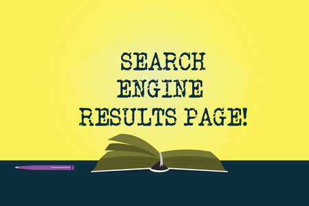 Conceptual hand writing showing Search Engine Results Page. Business photo showcasing Website created to display searching result Color Pages of Book on Table with Pen and Light Beam Glaring Stock Photo