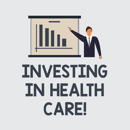 Text sign showing Investing In Health Care. Conceptual photo Make investments in wellbeing medical insurance Man in Business Suit Standing Pointing a Board with Bar Chart Copy Space Banque d'images