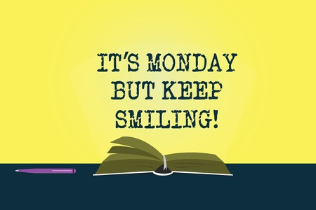 Conceptual hand writing showing It S Monday But Keep Smiling. Business photo showcasing Have a good start of the week day Motivation Color Pages of Book on Table with Pen and Light Beam Glaring