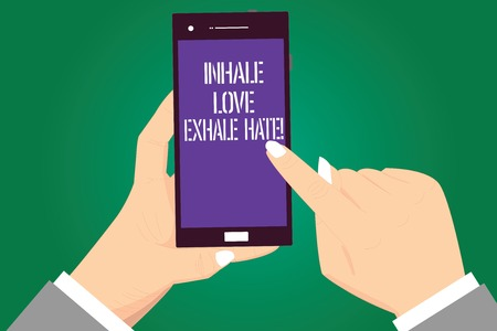 Handwriting text Inhale Love Exhale Hate. Concept meaning Positive do not be full of resentment Relax Hu analysis Hands Holding Pointing Touching Smartphone Blank Color Screen 免版税图像