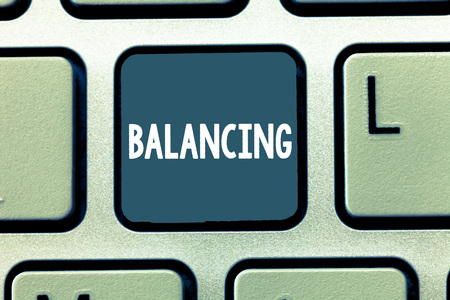 Conceptual hand writing showing Balancing. Business photo showcasing put something in a steady position so that it does not fall Keyboard Intention to create computer message keypad idea Stock Photo