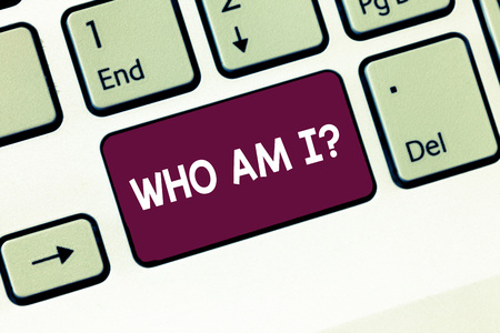 Writing note showing Who Am I question. Business photo showcasing when being asked about your name status and nationality Keyboard Intention to create computer message keypad idea Stock Photo